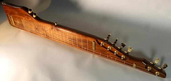One of the custom instruments produced at Aum Guitars
